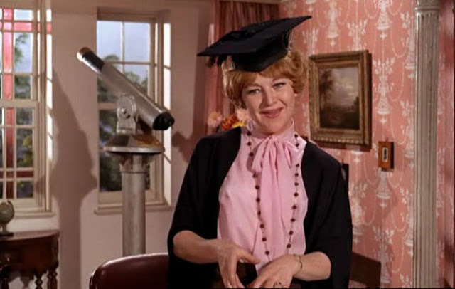 Dora Bryan as Amber Spottiswood