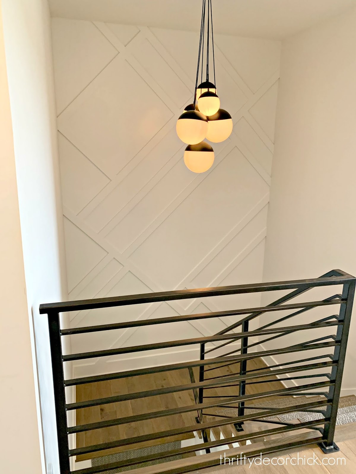 Modern staircase with trim on walls metal railings