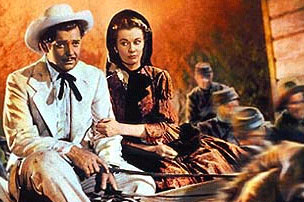 Clark Gable as Rhett Butler driving Scarlet O'Hara played by Vivien Leigh through burning Atlanta in Gone with the Wind movieloversreviews.filminspector.com