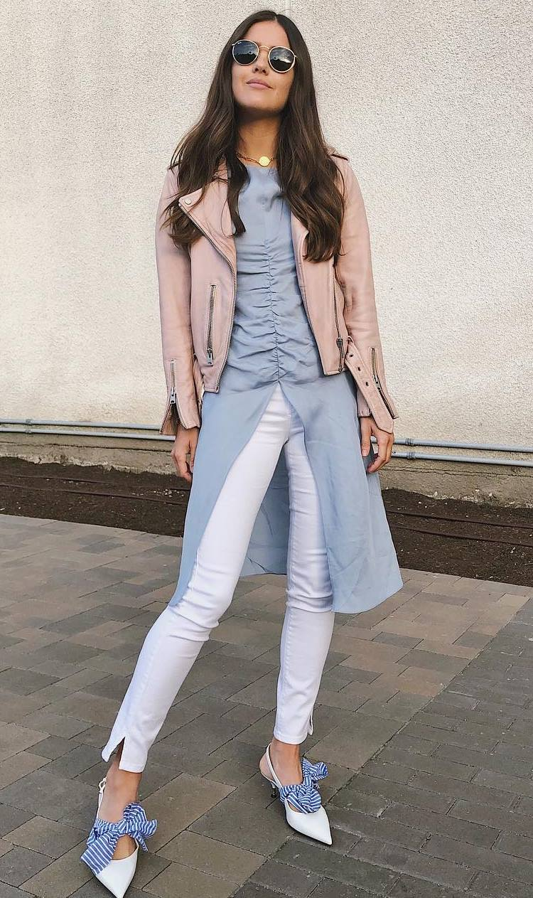 trendy fall outfit with a pink moto jacket : blue shirt dress + white skinnies + heels