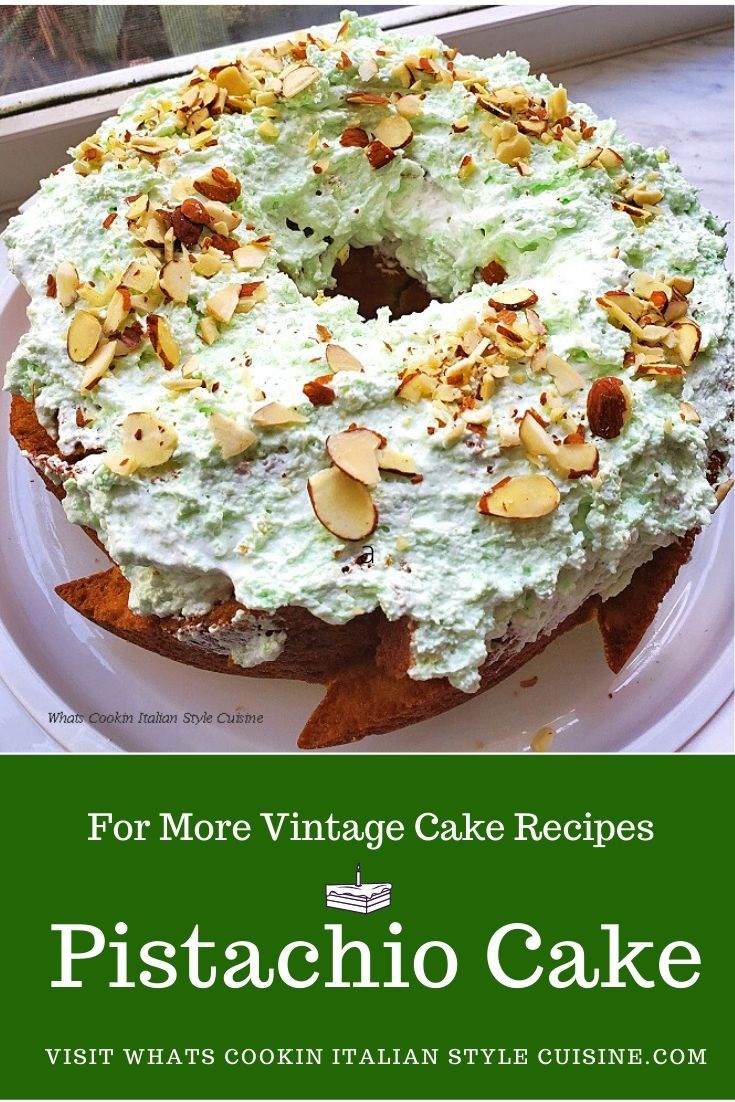 this is a pistachio cake using a cake mix and pudding in the mixture with a pistachio whipped cream and garnished with pistachios and sliced almonds