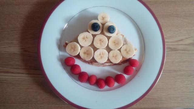 Pancake with nutella filling banana, berries