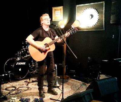 Don McGlashan playing guitar and signing at Smith's Alternative.