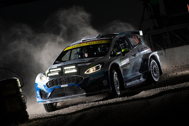 Ford Fiesta WRCar in dark with spot lights on Swedish Rally