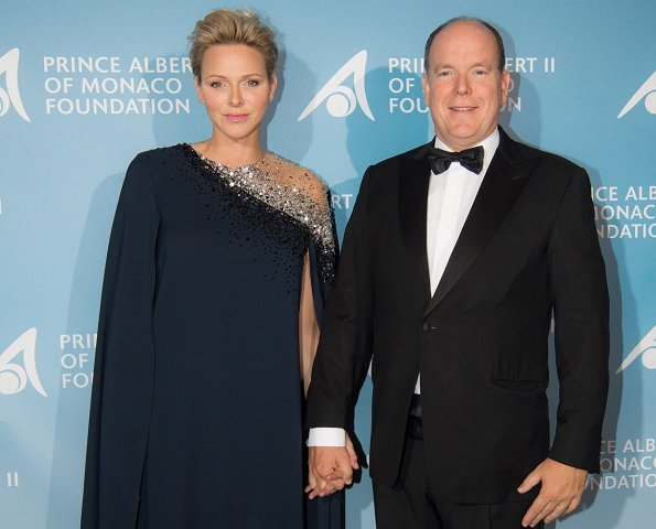 Princess Charlene wore Oscar De La Renta Navy Embroidered Illusion And Stretch-Georgette Cape-Back Caftan
