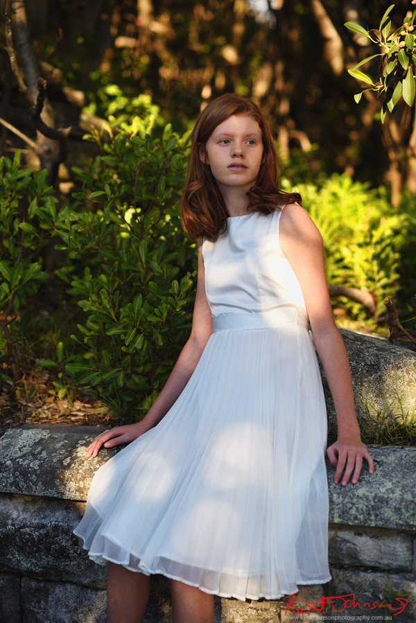 Portrait in dappled light, white confirmation dress - Photography by Kent Johnson