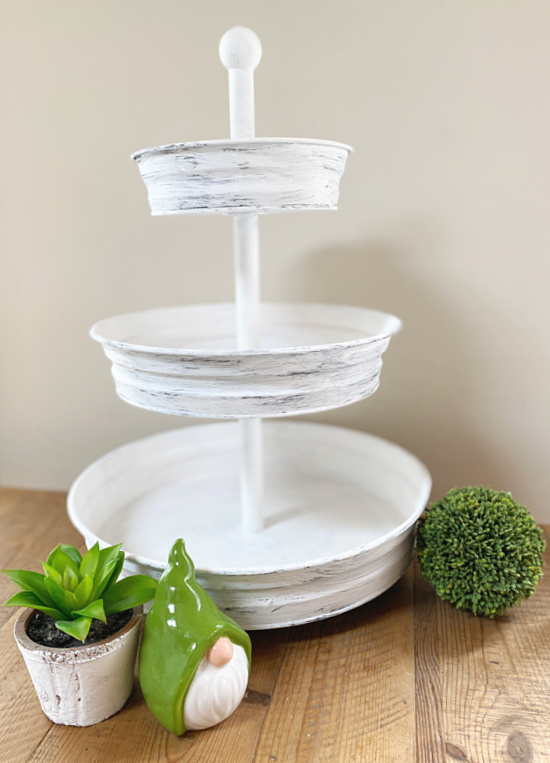white tiered tray with gnome and plant