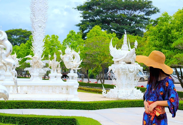 White Temple Thailand Girl in Peacock Dress and Hat