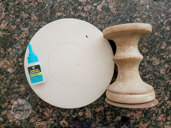 glue wood round to candlestick base