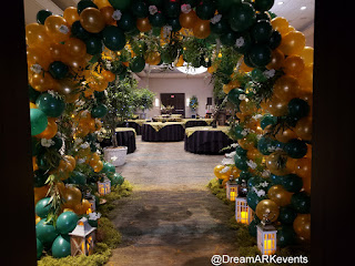 Tunnel decoration with branches, balloons, and flowers