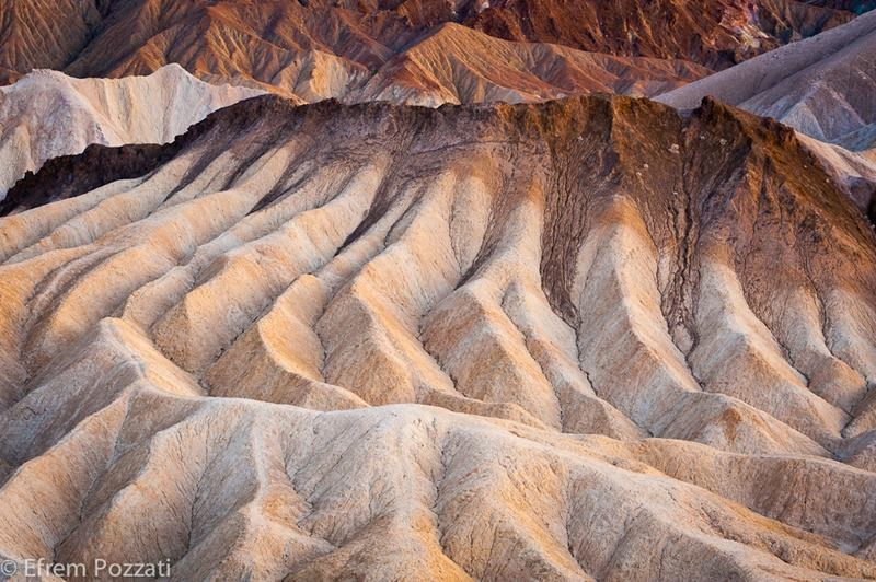 Zabriskie Point is a part of Amargosa Range located east of Death Valley in Death Valley National Park in California, United States noted for its erosional landscape. It is composed of sediments from Furnace Creek Lake, which dried up five million years ago—long before Death Valley came into existence.