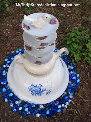 Thrift Store Yard Art: Tea Cup Tower mythriftstoreaddiction.blogspot.com Repurpose thrift store tea cups as garden art!