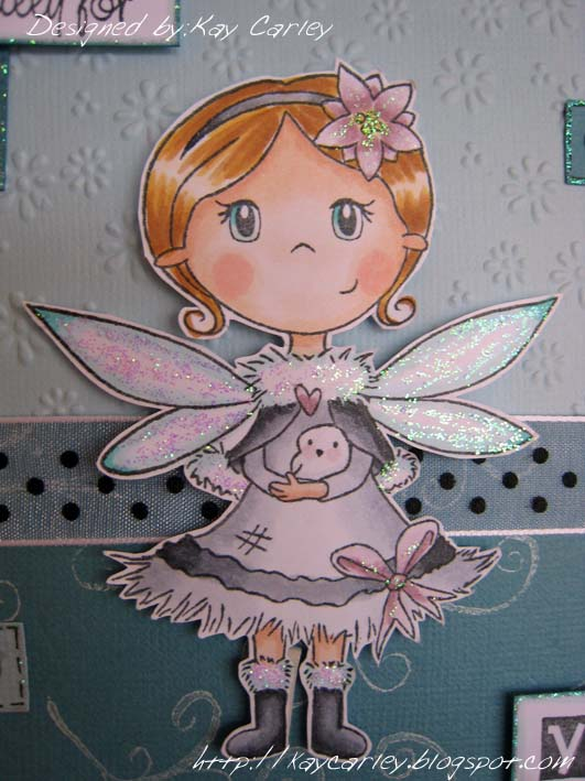 i stamped phoebe with dove onto smooth white cardstock with black memento ink and coloured her with copic markers before glittering her wings etc with
