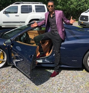 Yulanda Simon's husband Miguel A Nunez Jr posing for picture with a car