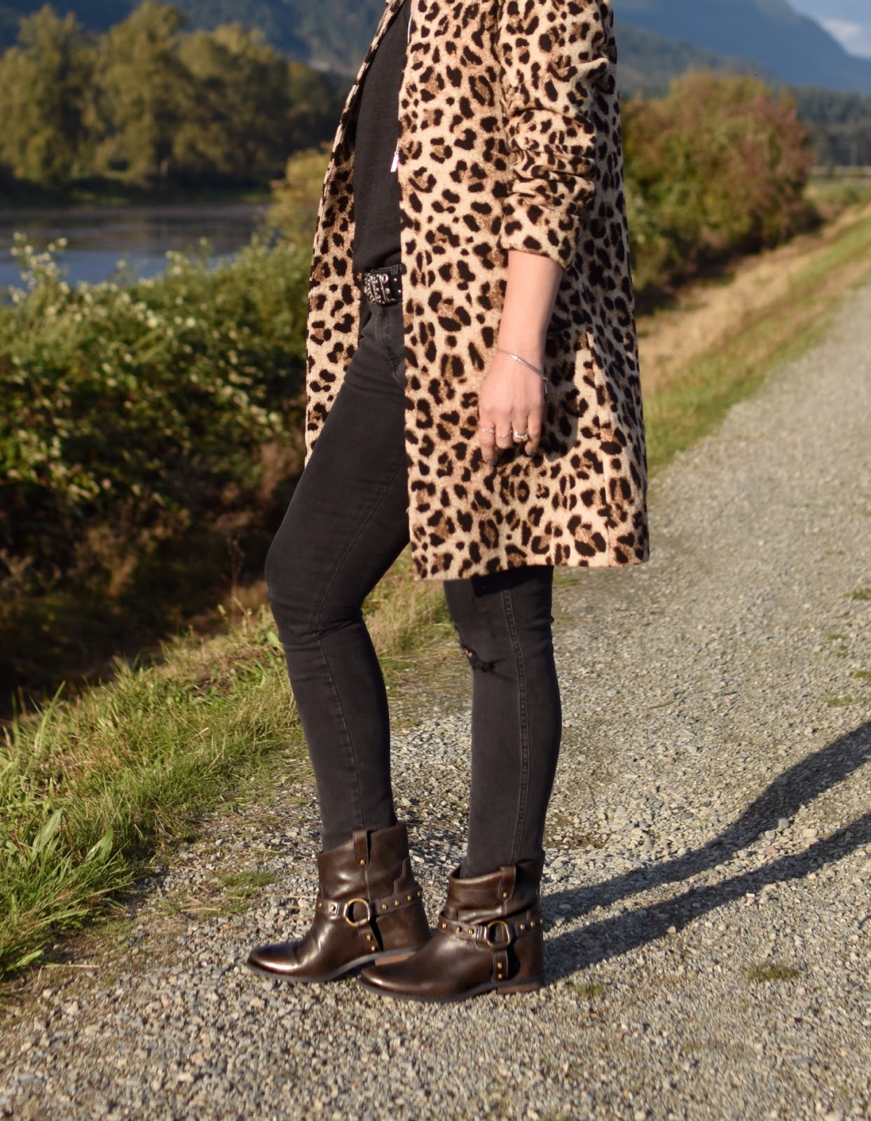 Monika Faulkner outfit inspiration - distressed black skinny jeans, leopard-patterned coat, hidden-wedge booties