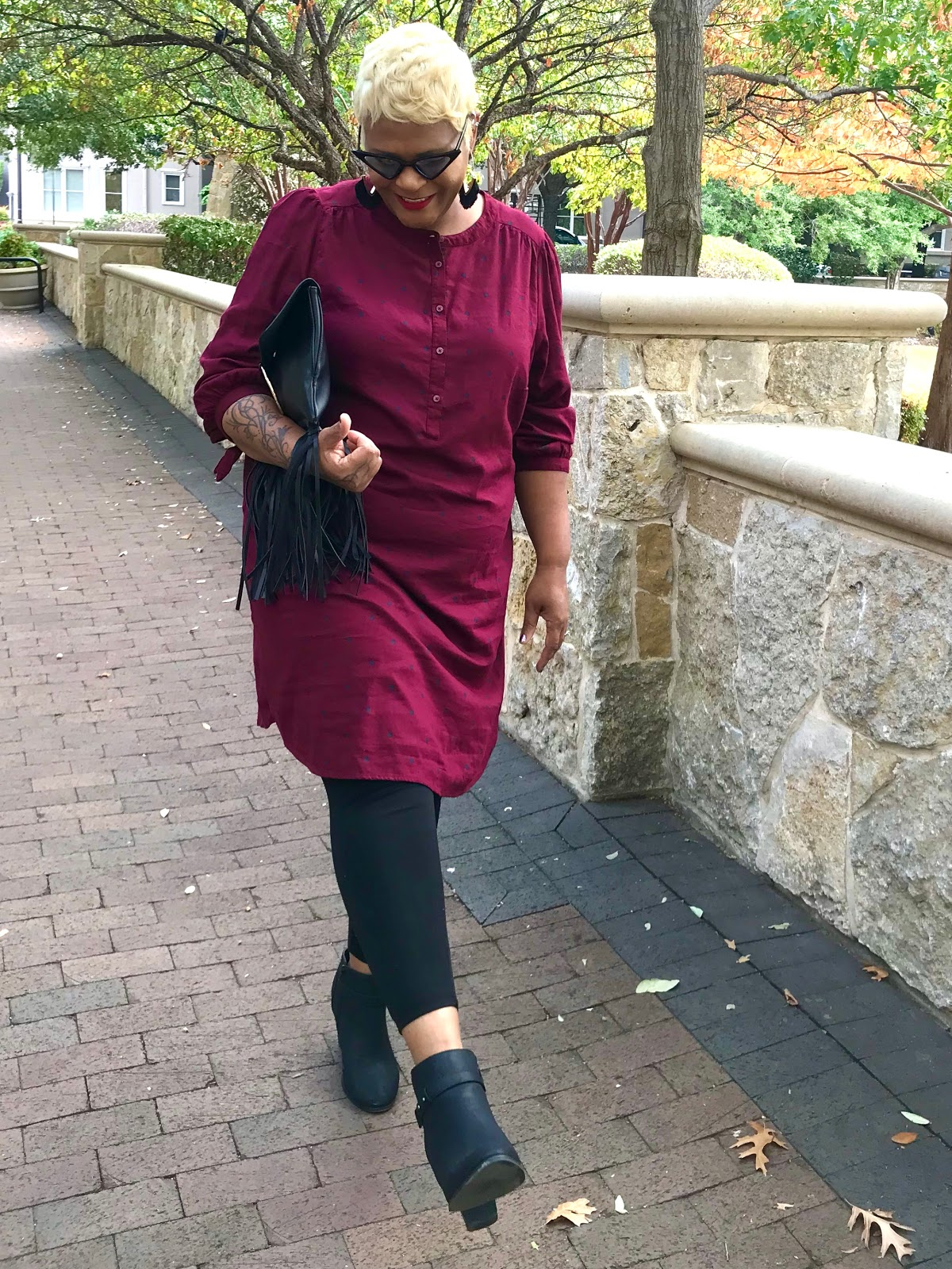 Tangie Bell is showing how she restyled black boots, leggings and shirt dress