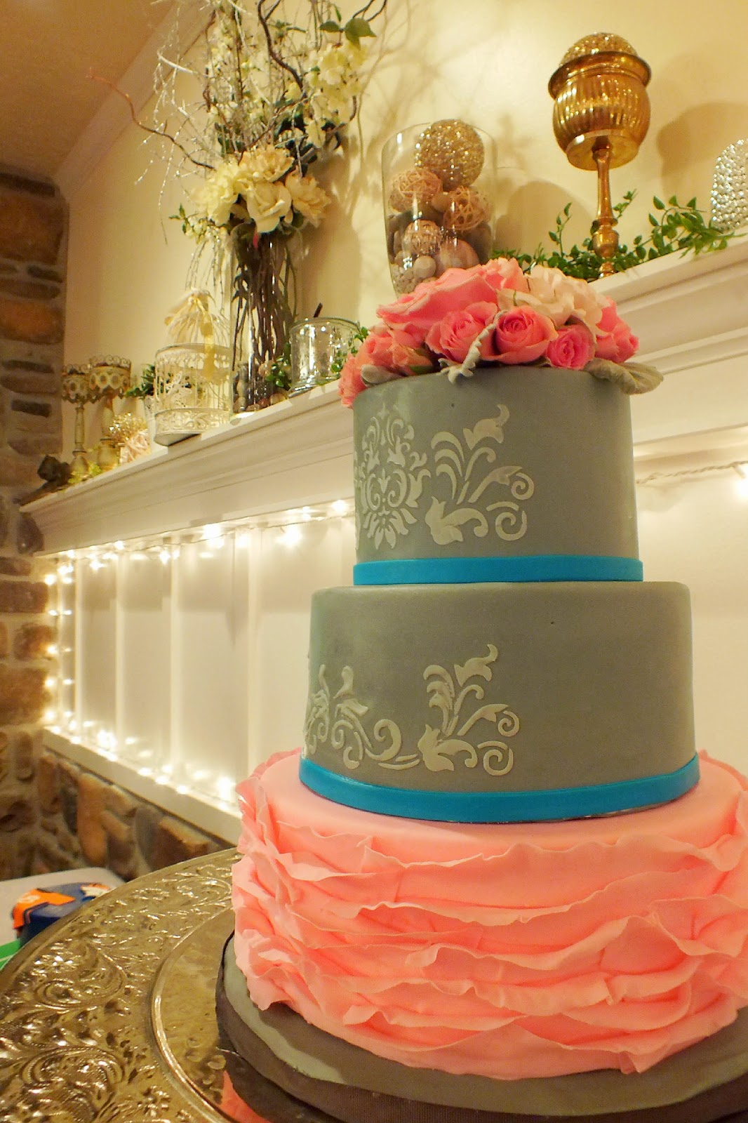 Navy blue wedding cake with pale pink flowers. Created by ... |Pink And Blue Wedding Cakes