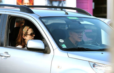 Anne Stringfield with her husband sitting inside the car