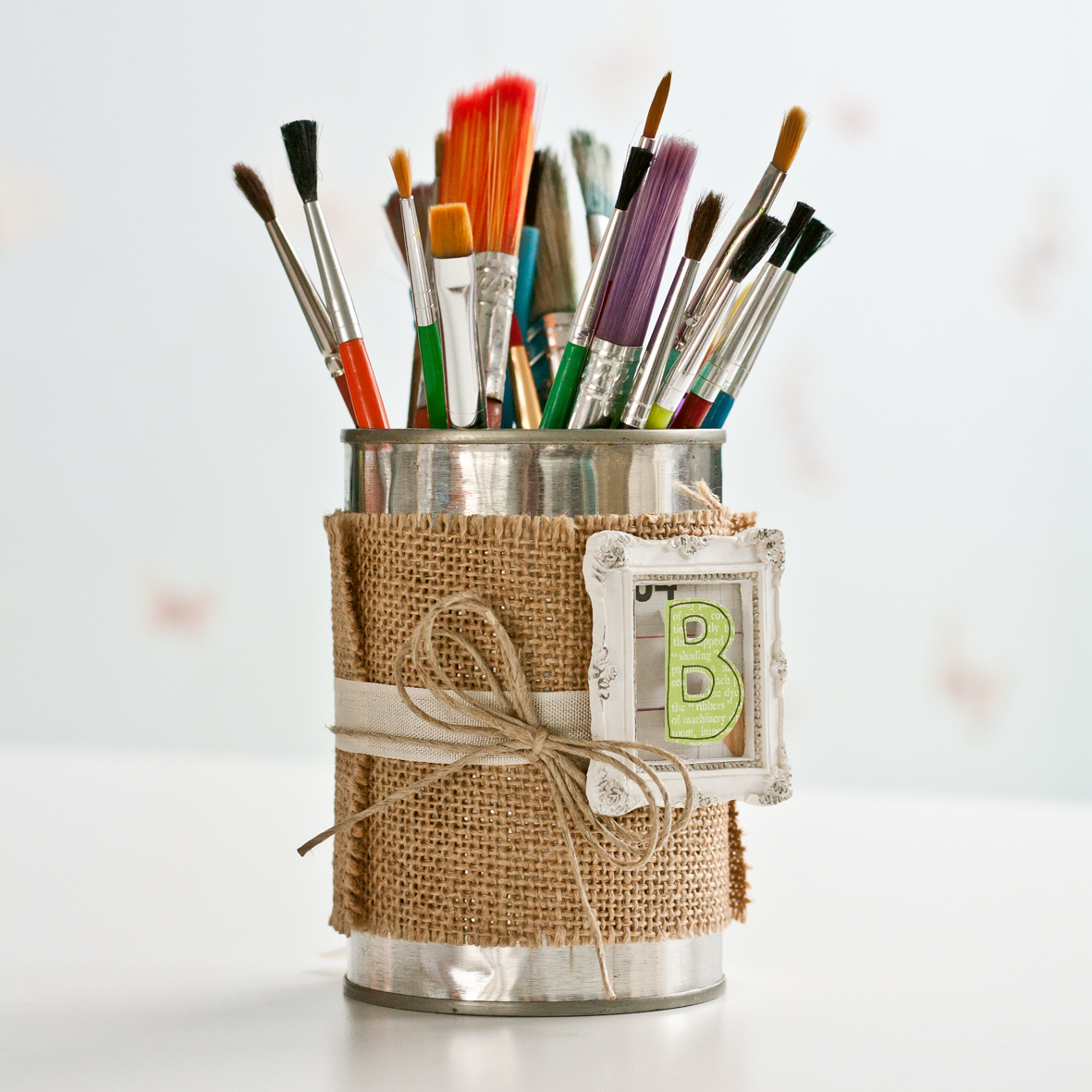 Tin can upcycled into a brush holder