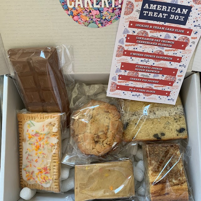 Treat Box containing American themed cakes and biscuits