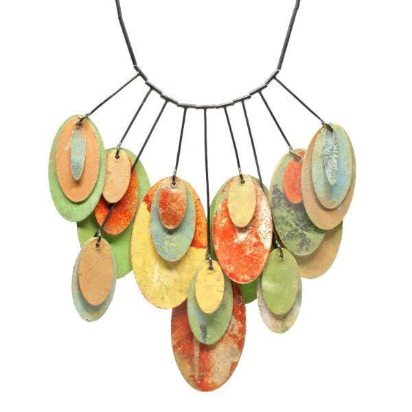 necklace of suspended pastel printed paper oval discs