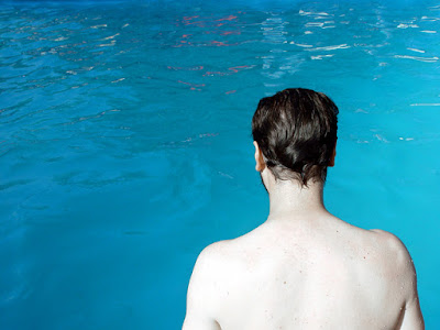 Picture of a man looking at the water. Why am I afraid to put my head under water?