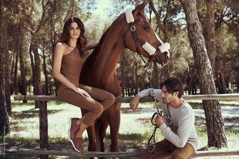 Isabeli Fontana poses with a horse in Carmela Shoes fall-winter 2019 campaign