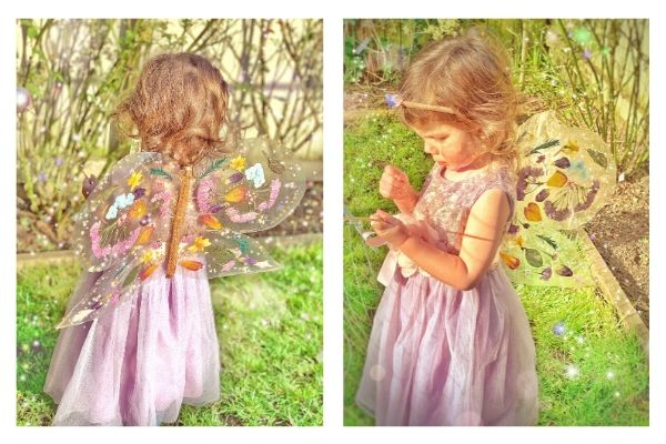 girl wearing DIY fairy butterfly wings made with tacky back plastic and flowers