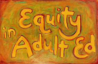 """""""Equity in Adult Ed"""" painted in yellow letters against a background of mixed green, yellow and red"""