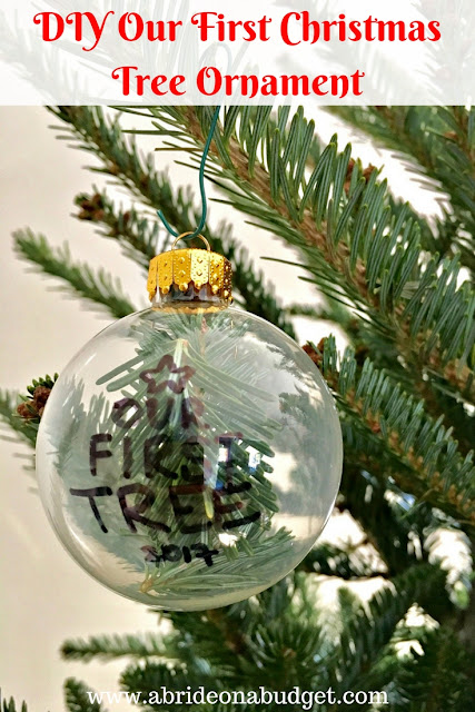 Before you throw out your Christmas tree, be sure to make this DIY Our First Christmas Tree Ornament from www.abrideonabudget.com.