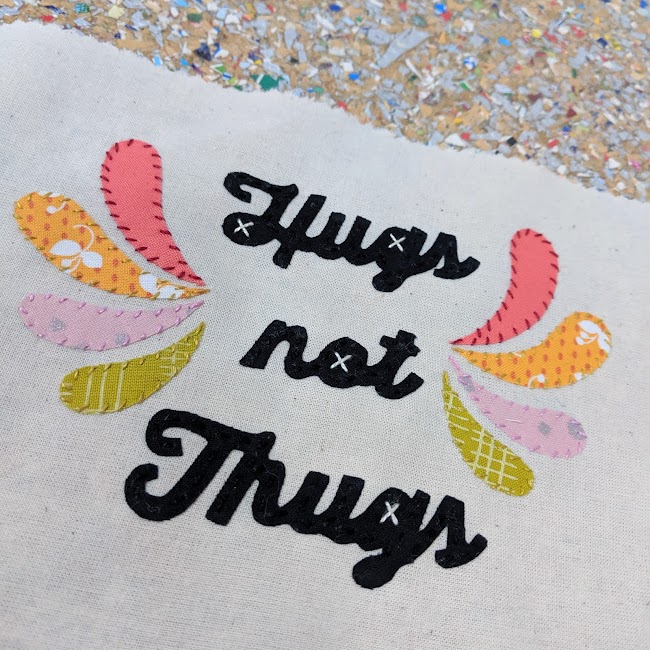 hugs not thugs mini banner