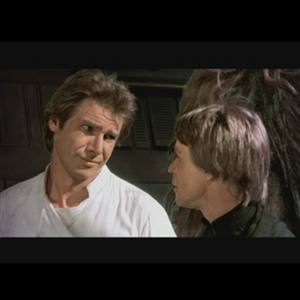 Han Solo gives Luke a skeptical look in one of the Star Wars movies.