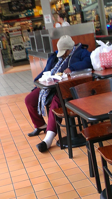 Lady sleeping at the Mall of America