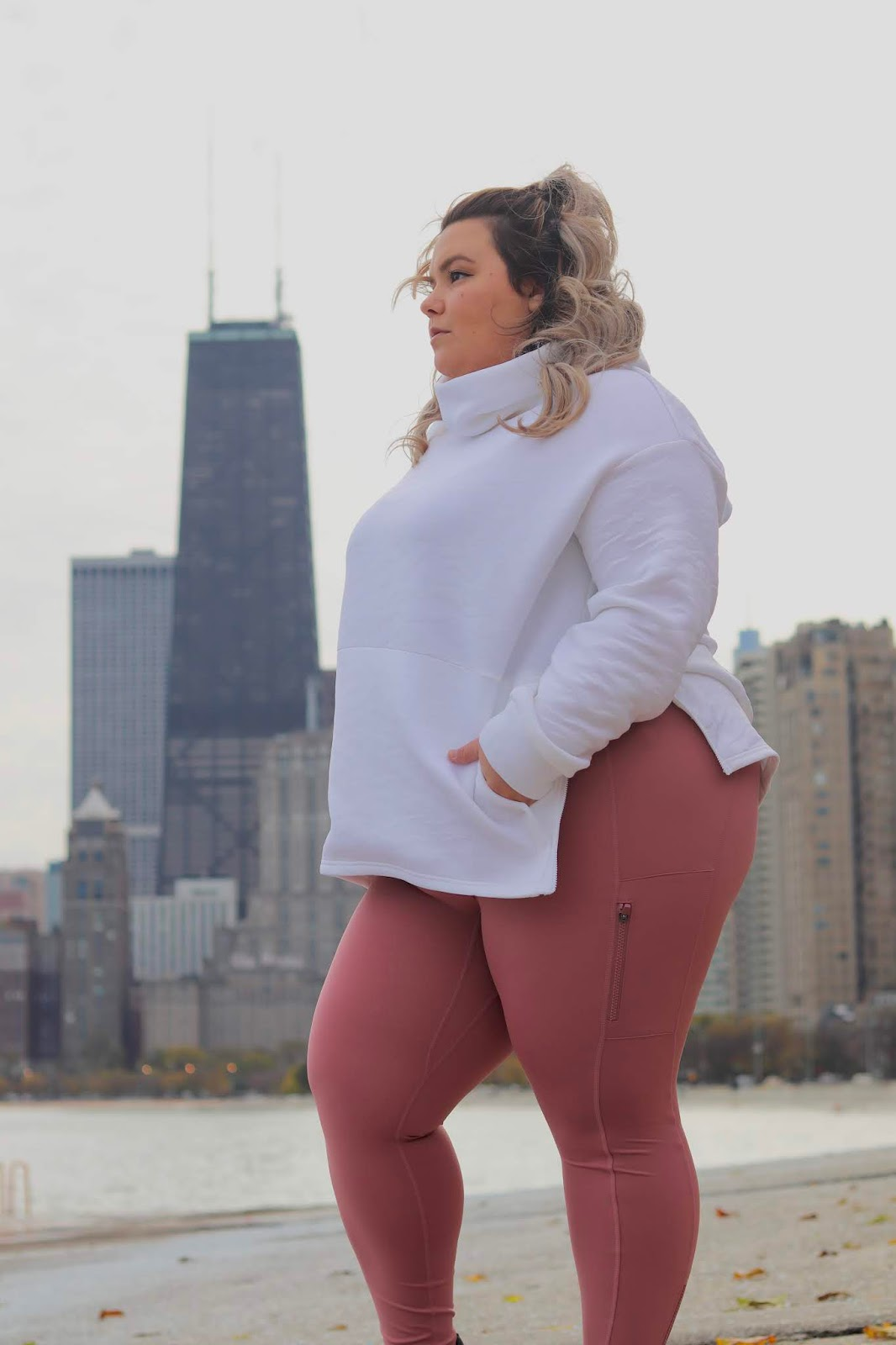 Chicago Plus Size Petite Fashion Blogger, influencer, YouTuber, and model Natalie Craig, of Natalie in the City, reviews Fabletics winter workout attire.