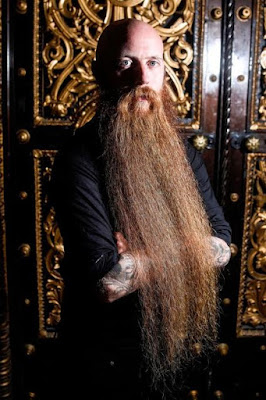 The man with Britain's longest beard measuring over 2ft has been growing it for six years