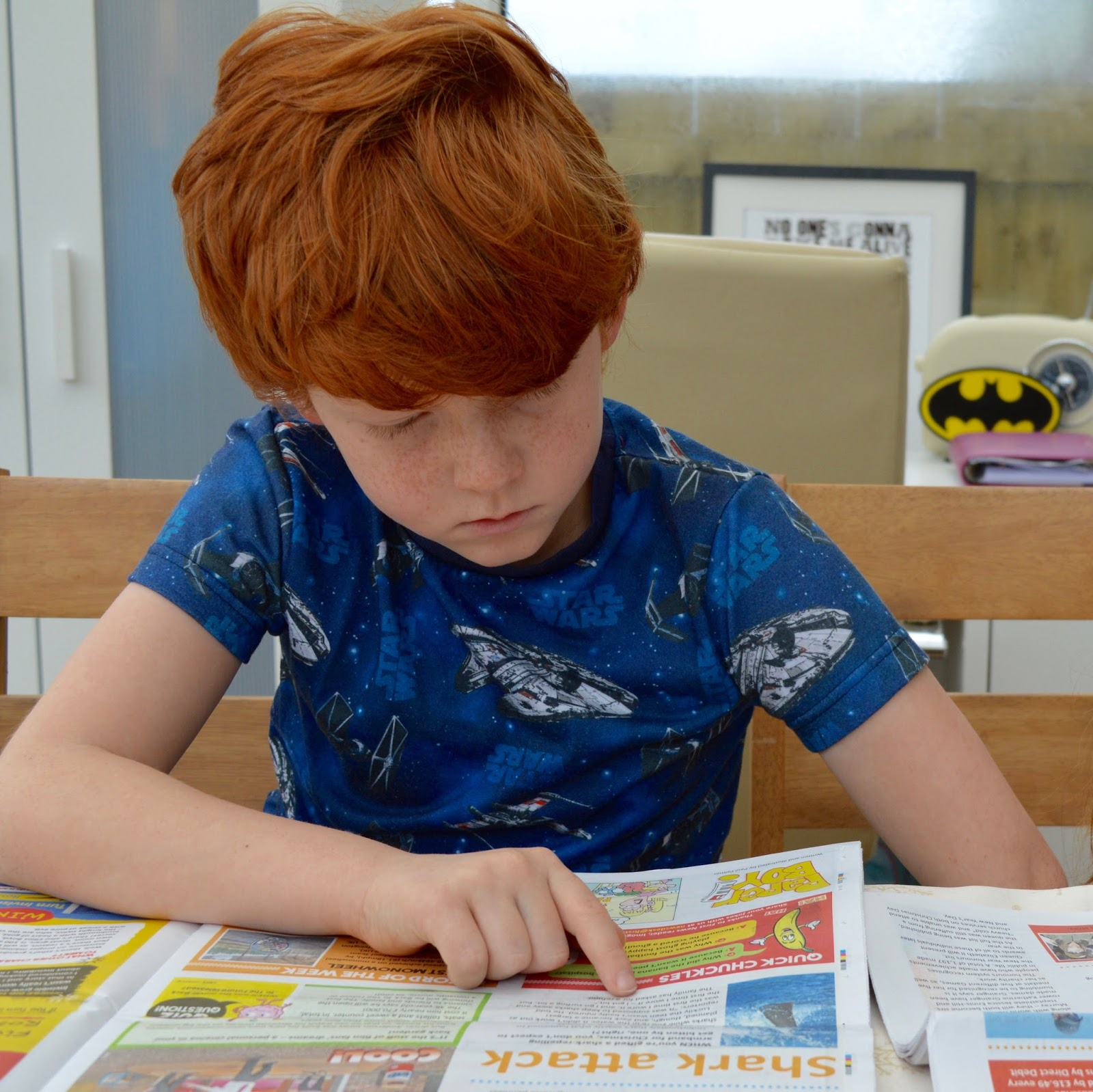 First News Newspaper features and review. A fantastic resource to encourage discussion for children and young people aged 7- 14 years. Plus a special trial offer for our readers.  - Harry reading news