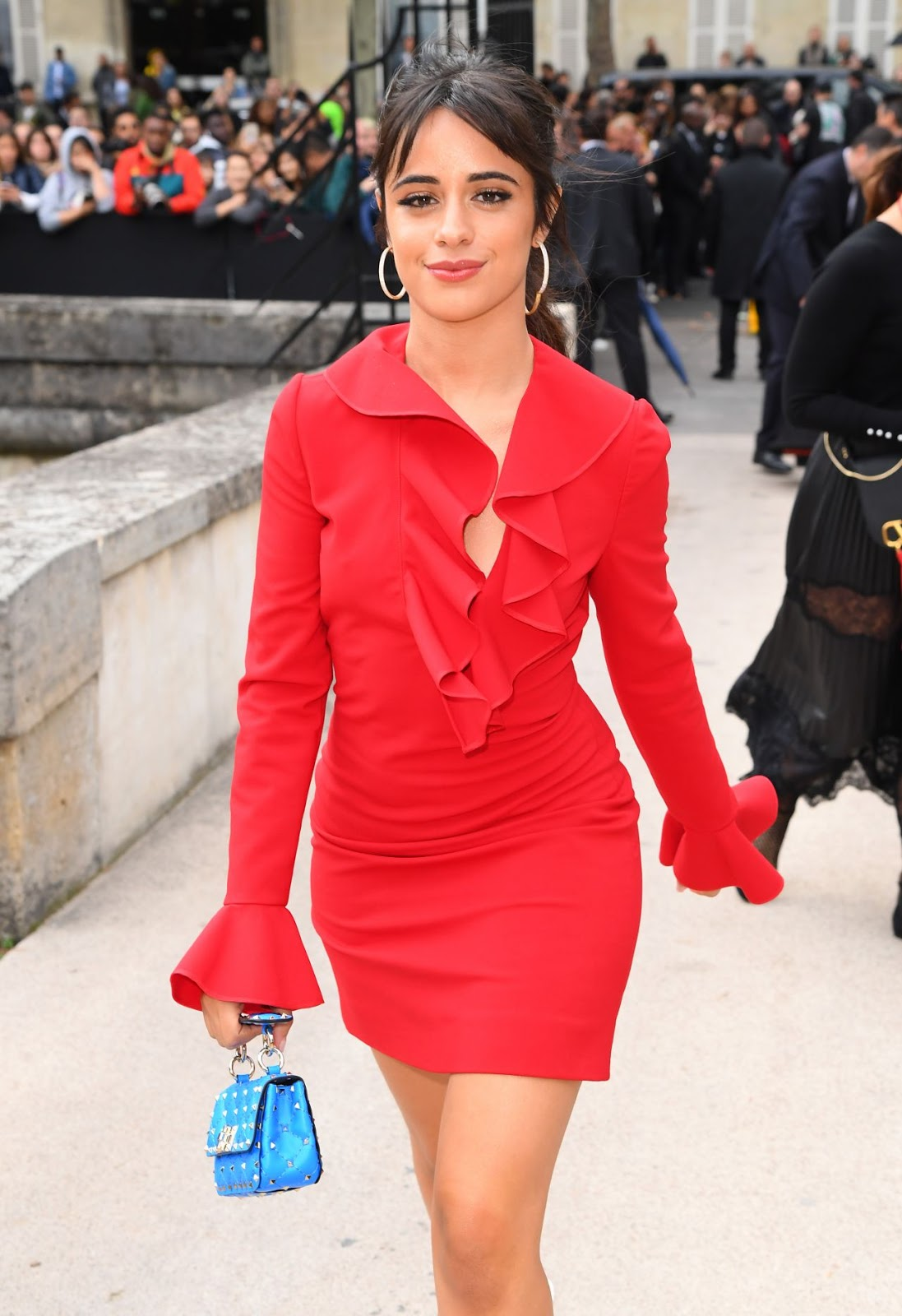 Camila Cabello flashes her cleavage in a daring red dress with a plunging neckline