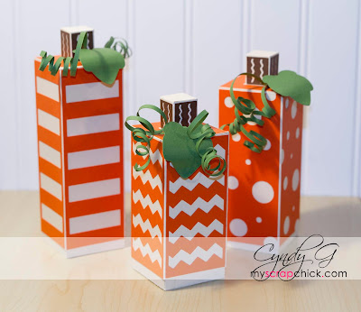 Three square paper pumpkin boxes in varying sizes