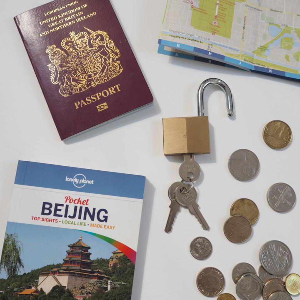 Passport, padlock, travel guide