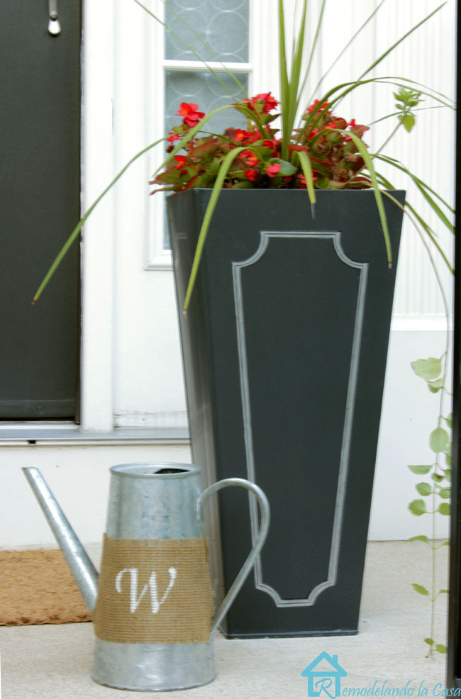 black metal planter on front porch