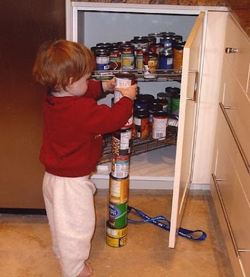 Autism Spectrum Disorders (ASD): Autistic boy obsessively stacking cans
