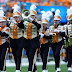 University of Tennessee marching band wears T-shirts designed by bullied 4th grader