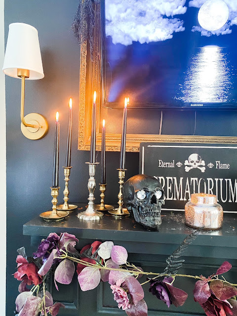 Brass candlesticks with black candles
