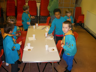 beaver scouts icing biscuits with chocolate buttons