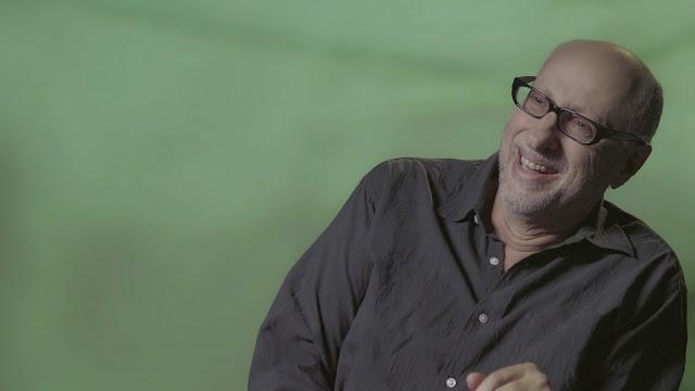 Luiz Zanin sorrindo durante entrevista
