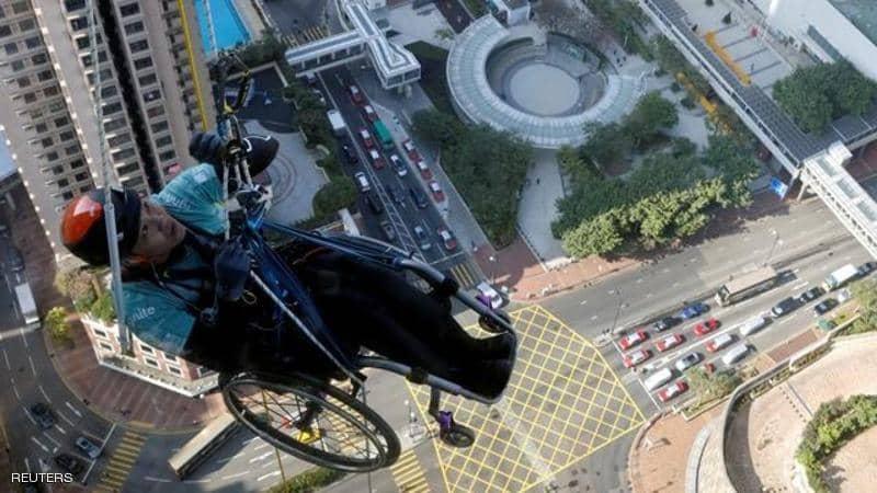Lai Chi-wai ... climbs a wheelchair skyscraper