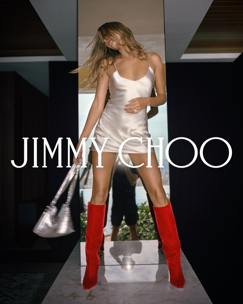Model Hailey Bieber wears red boots in Jimmy Choo fall 2021 campaign