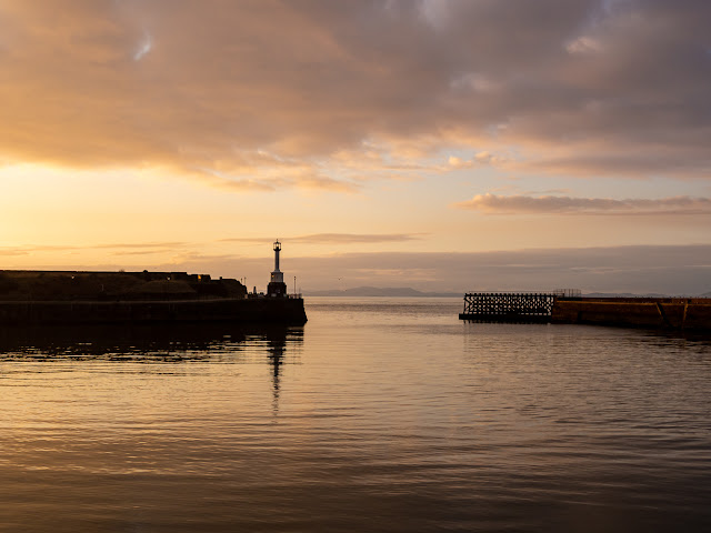 Photo of the sun going down over Maryport Basin