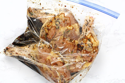 Raw chicken legs in a bag with marinade