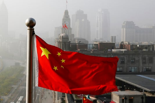 A city in the background of Chinese Flag